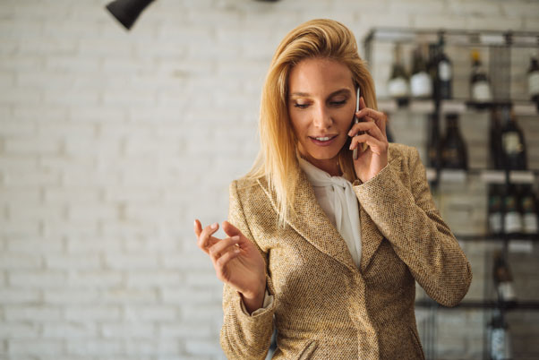 Blonde woman indoors on a business call
