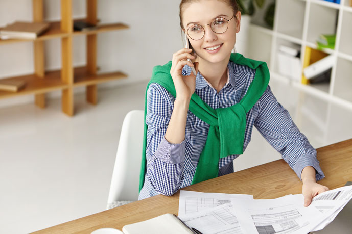 Young business woman with scarf on her phone