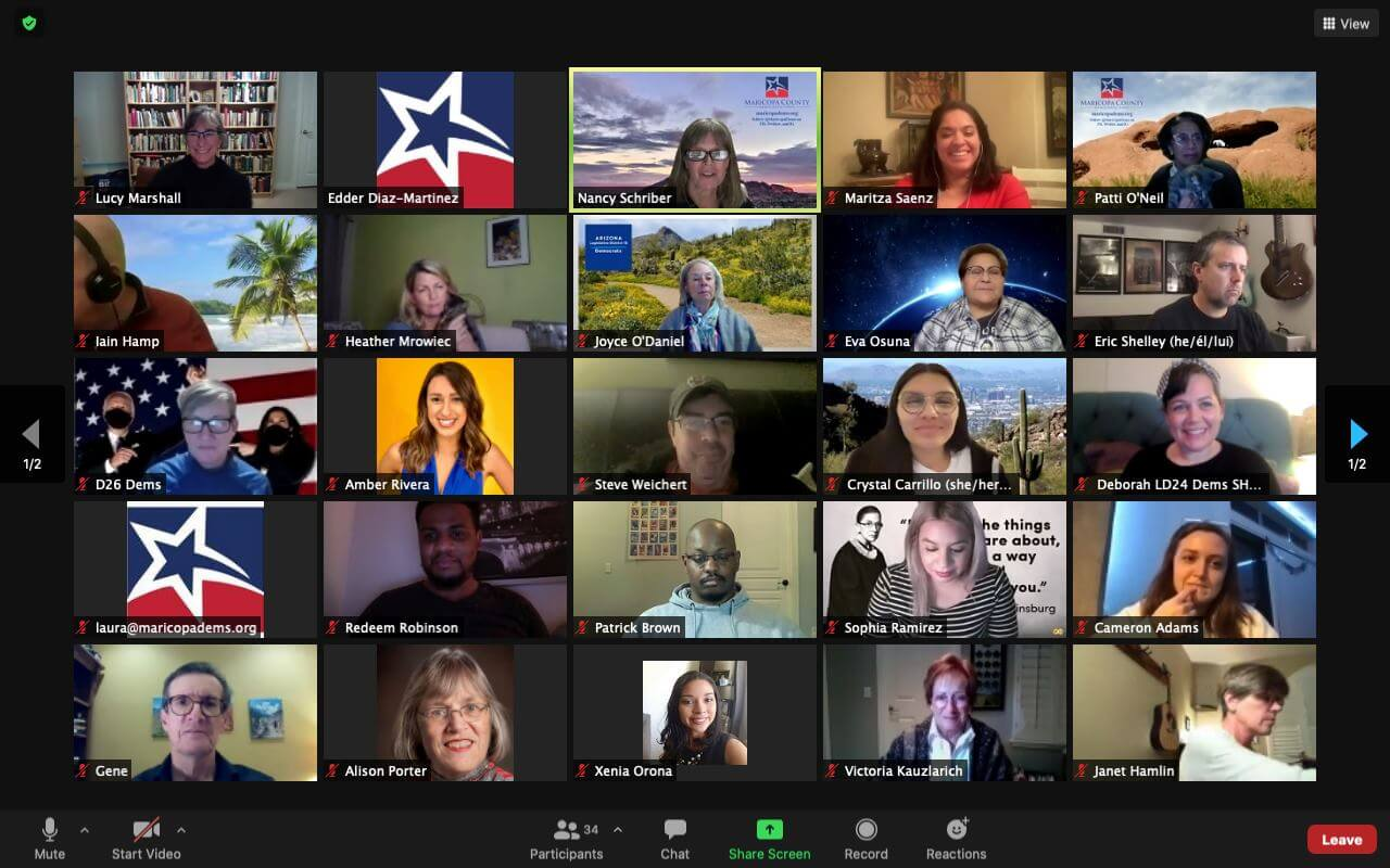 A zoom meeting with lots of participants smiling.