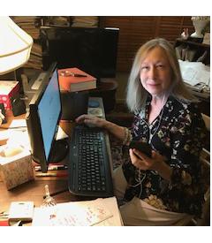 Volunteer at her computer.