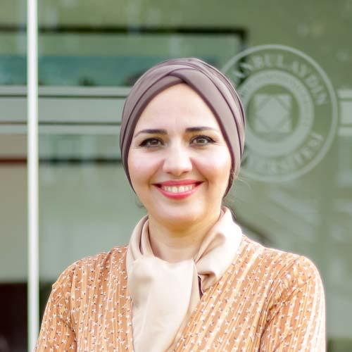 Portrait of a smiling Raghda Lutfi