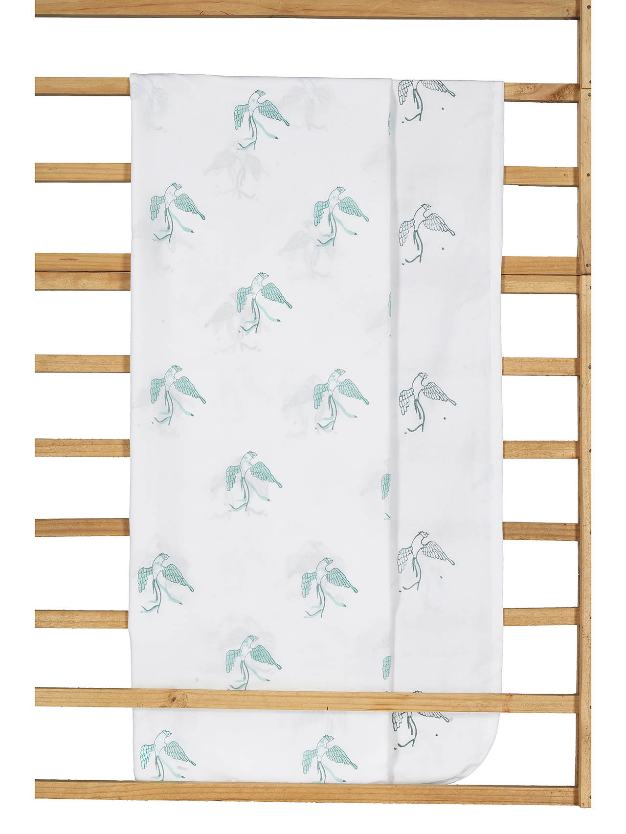 The tradition of crafting baby blankets from fine mulmul is centuries old – cotton voile (mulmul) fabrics are soft, durable, breathable and have a natural 'give'. Our classic baby blankets feature three layers of 100% cotton mulmul in a 44-inch square, specifically designed to provide babies with the comfort they deserve. Use it for cuddling, swaddling or as a 'snuggly' surface to lay your little one. Our mulmul is prewashed to give you an incredibly soft baby blanket that stays that way, wash after wash. Block printed by hand, every motif on theblanket is unique: the pattern on the front is colored while the reverse is it's simplified variant.