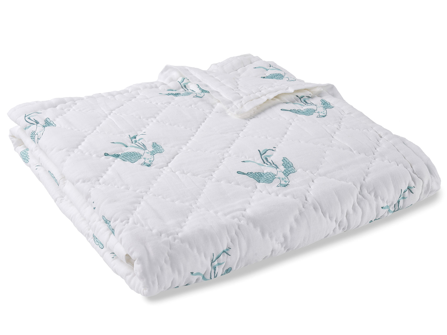 Your baby should not have to wake up in a film of sweat with stale air trapped within a thick stuffy quilt. Quilts should breathe just as we do. Our solution is simple and tried and tested over generations: cotton, cotton, cotton! All our quilts are constructed from fine breathable cotton voile and filled with pure organic cotton. As a result, the quilts are lightweight and porous, allowing moisture to evaporate. An ADITYA AHUJA quilt is soft, comfortable and impeccably hand crafted. Our quilts are hand stitched in small diamond patterns. With a hand-block print on the front, the reverse is a pure white-on-white diamond stitch. So, if you ever need to shake things up, turn it around and enjoy your new, modern and minimalistic quilt.