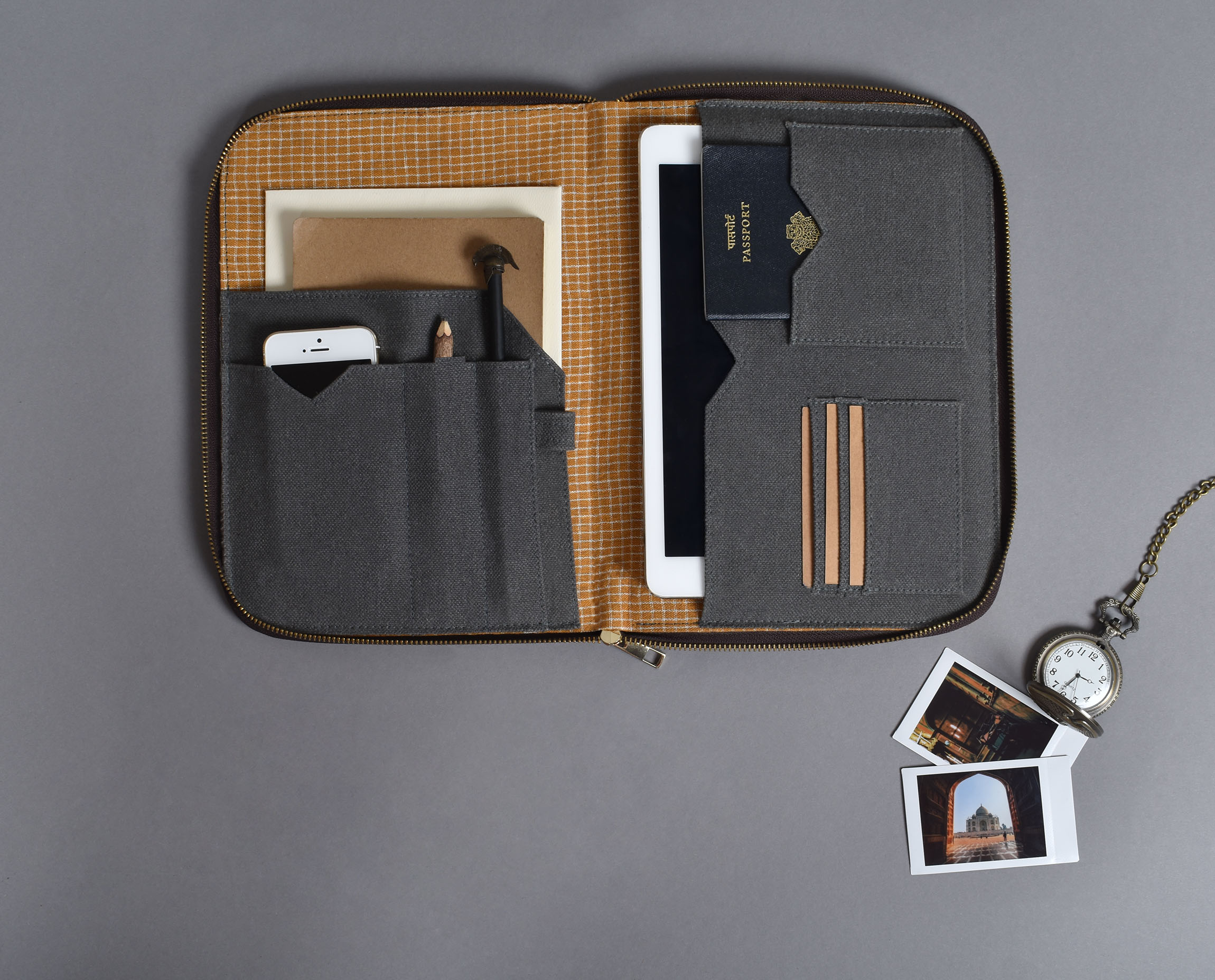"""""""Heading for a meet or traveling, this Tech Organizer is quite handy and versatile for multiple working functions. Effortlessly organize your tablet, phone, diary, stationery, and other accessories in one single zipper compartment with this gender-neutral Tech Organizer. It fits in all your work, meet and travel essentials in a place. It is designed for easy and fast access to your essentials, preventing the task of digging for minutes into your heavily filled bags. It helps you keep your things in place, to understand and carry what is necessary and stay decluttered. The organizer fits in tablets of the body dimension equals or less than 9.75 inches by 7 inches. Fit for a quick wash (dry clean only)."""""""