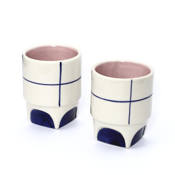 """""""This collection is inspired by two opposing philosophies in Design & Architecture.At strange co. we have tried to find a balance between those two and applied it on a simple object like a mug. The lines symbolize window panes, one of the key features in Corbusier's style of architecture, are hand painted with 24 carat Gold Handmade Ceramic . Hand Painted with 24 Ct gold . Lead Free . Ideal for both Hot and Cold Beverages """""""