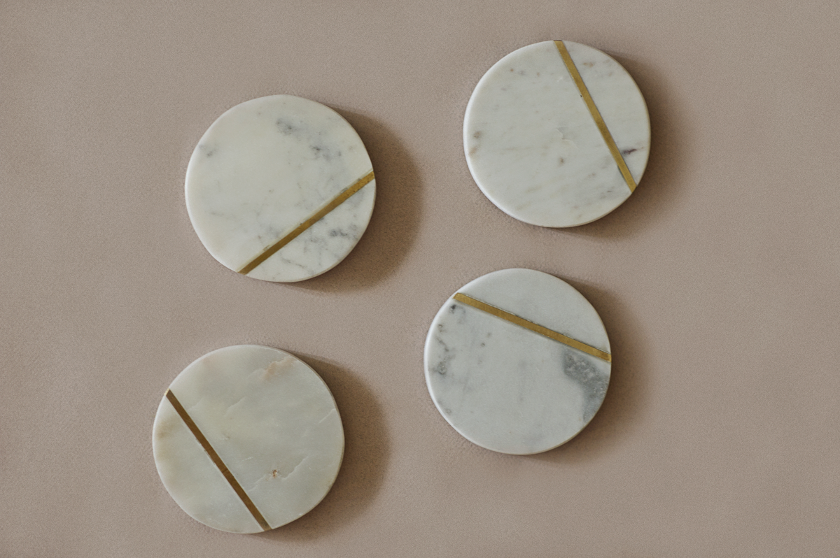 """""""Crafted from natural marble stone with a brass inlay, these unique coasters are a sure to add a pop of colour and character to any table setting. These also make for a great gift for family and friends. Measurements- Approximately 4"""""""" to 4.5"""""""" diameter NOTE-Natural stone will vary in size, colour, and appearance.Each piece is one-of-a-kind; size, shape, and colour may vary slightly. Listing is for Set of 4 """""""