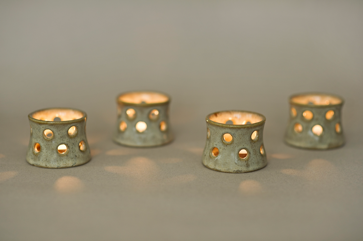 """"""" These beautifully crafted candle holders are the perfect decorative pieces for your table or shelf. It's specially made to hold tea lights and creates amazing light effects when the candle is lit. These gorgeous Pearl Tea Light Candle Holders are sure to become a favourite piece in your home decor collection this Holiday Season! Measurements- 1.75"""" in height and 2.35"""" wide NOTE- Due to the nature of handmade ceramics variations in exact texture and glaze can occur. Colours may vary slightly from what you see on your screen, depending on your settings. Listing is for a set of 4"""""""