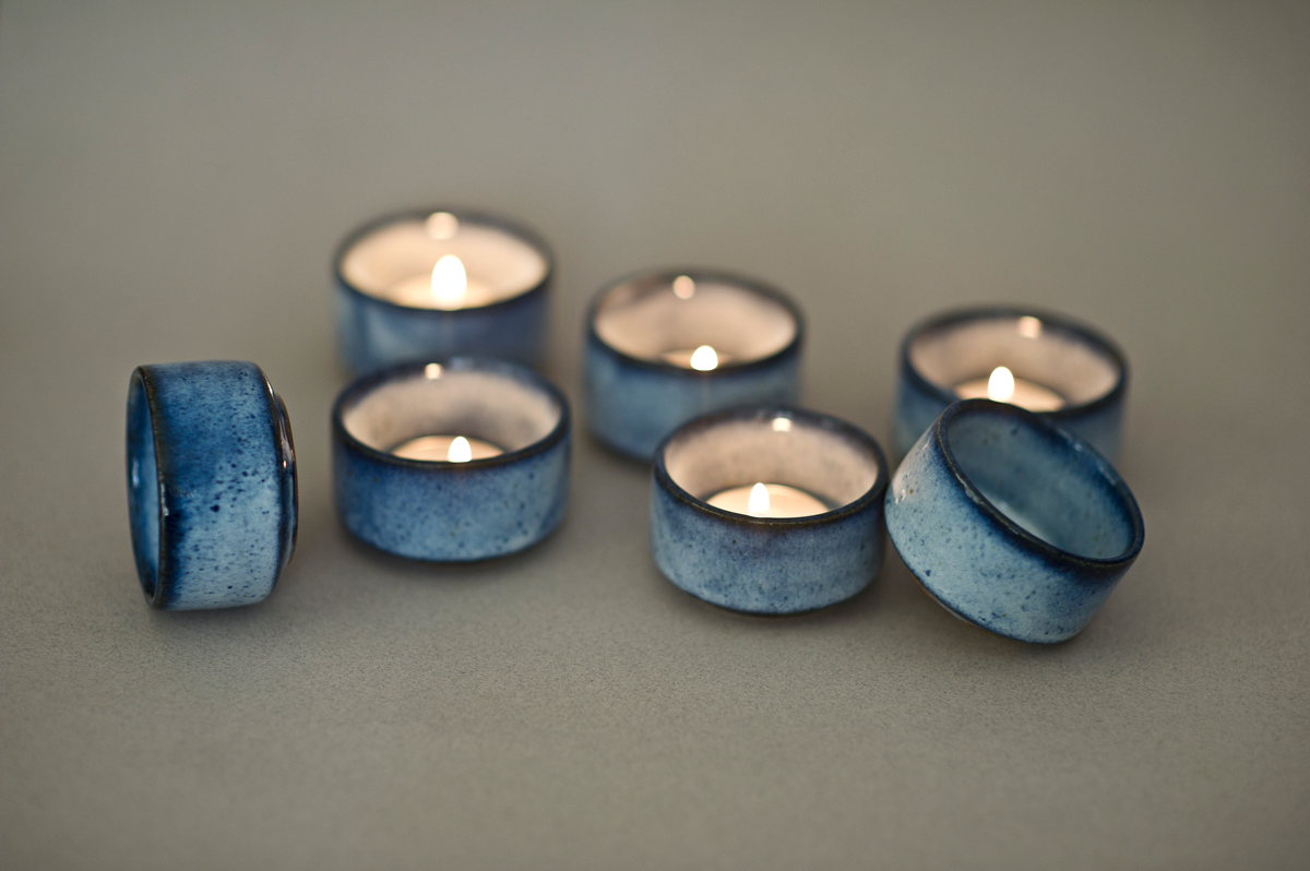 """""""These beautifully crafted candle holders are the perfect decorative pieces for your table or shelf this Festive Season.Specially made to hold tea lights, these gorgeous Marbled Blue Tea Light Holders are sure to become a favourite piece in home decor collection! Measurements- 1.5"""" in height and 2.6"""" wide at rim NOTE-Due to the nature of handmade ceramicsvariations in exact texture and glaze can occur.Colours may vary slightly from what you see on your screen, depending on your settings. Listing is for a set of 4"""""""