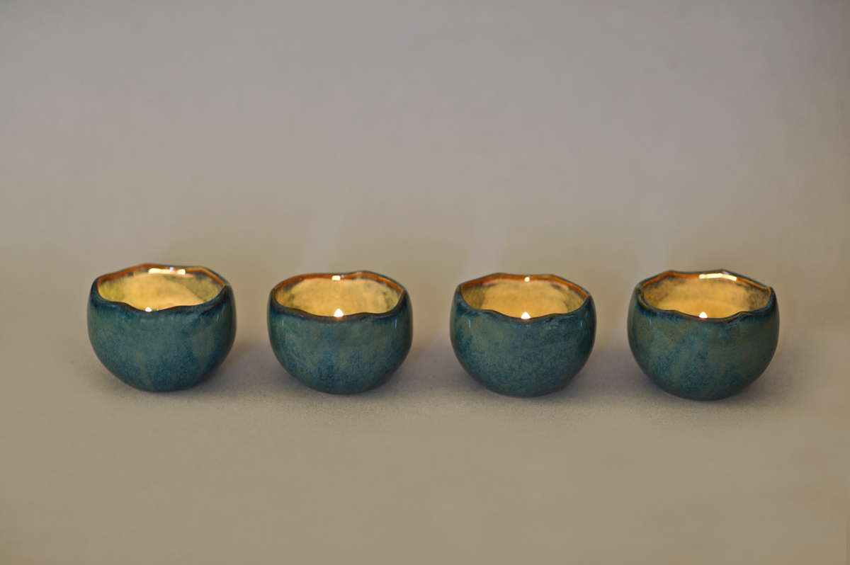 """""""These beautifully crafted candle holders are the perfect decorative pieces for your table or shelf. It's specially made to hold tea lights and creates amazing light effects on a wall when the candle is lit. These gorgeousJuniper Tea Light Candle Holders are sure to become a favourite piece in your home decor collection this Holiday Season! Measurements- 1.75"""" in height and 2.5"""" wide *Each listing includes 4 pieces NOTE-Due to the nature of handmade ceramicsvariations in exact texture and glaze can occur.Colours may vary slightly from what you see on your screen, depending on your settings. """""""