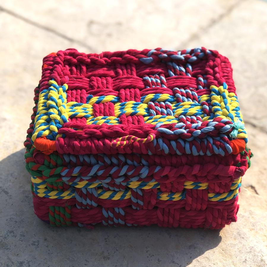 Inspired by vibrant lehenga-cholis from Northern India, this dainty storage box is made from upcycled colourful chindi or cloth rags on an iron frame and is an excellent choice as an organisation option that is both traditional and contemporary in design. The lid and entire box is handwoven by our skilled women artisans. Store collectible stationary or trinkets in this small yet smart design. ;