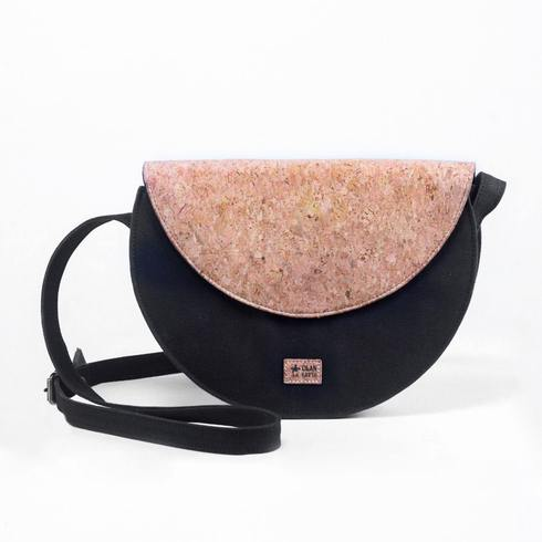 Classy, Elegant and a mix of contemporary silhouette and modern design Intricately handcrafted by experienced Kolkata artisans Designed to be stylish, functional and easy on the planet Made with Water Resistant Sustainable Fabrics, Cork and Cotton interlinings Completely vegan, plastic-free, leather-free and animal cruelty-free A mid compartment that the purse opens into and a zip pocket for small things Would hold 500 ml bottle, wallet, sanitizer, an A5 notebook, some stationery, make-up essentials, zero waste essentials