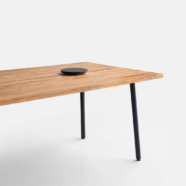 The Mool Table displays pure simplicity with its minimal form and clean lines, characterized by a uniform spacing in the middle of the table top. The table comes with a platform accessory in different shapes and materials to keep condiments and other items. The metal leg framework makes a sturdy silhouette for dinners and meetings. Light and modern, the table is both easy to maintain and a pivotal addition to virtually any space and can be assembled in seconds.