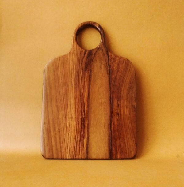 """""""Sleek and richly grained, our lovely Poka boards are excellent for chopping & food presentation. Made with high quality acacia wood by skilled artisans, this lovely and super useful piece will surely be a joy to have in your kitchen. Knife just for styling purposes. Not included with the board. Size: 33 x 23 cm"""""""