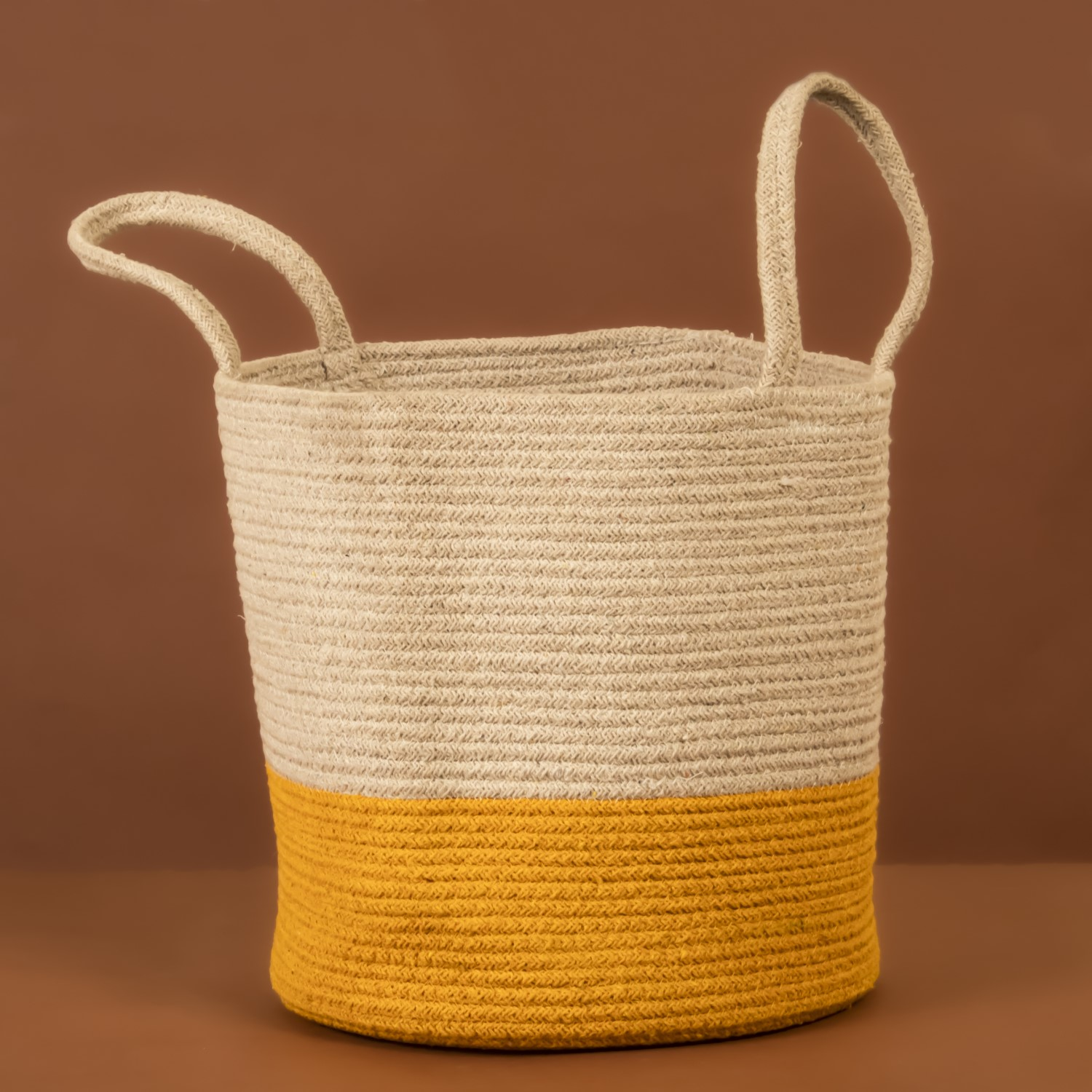 """""""A great organizer and planter, this chic multi-purpose handwoven jute & cotton blend basket is a must for any home. Excellent as a toy organizer as well as a laundry bag, it's sure to enhance your spaces while also being very useful! Size: 40 x 30 cm (approx)"""""""