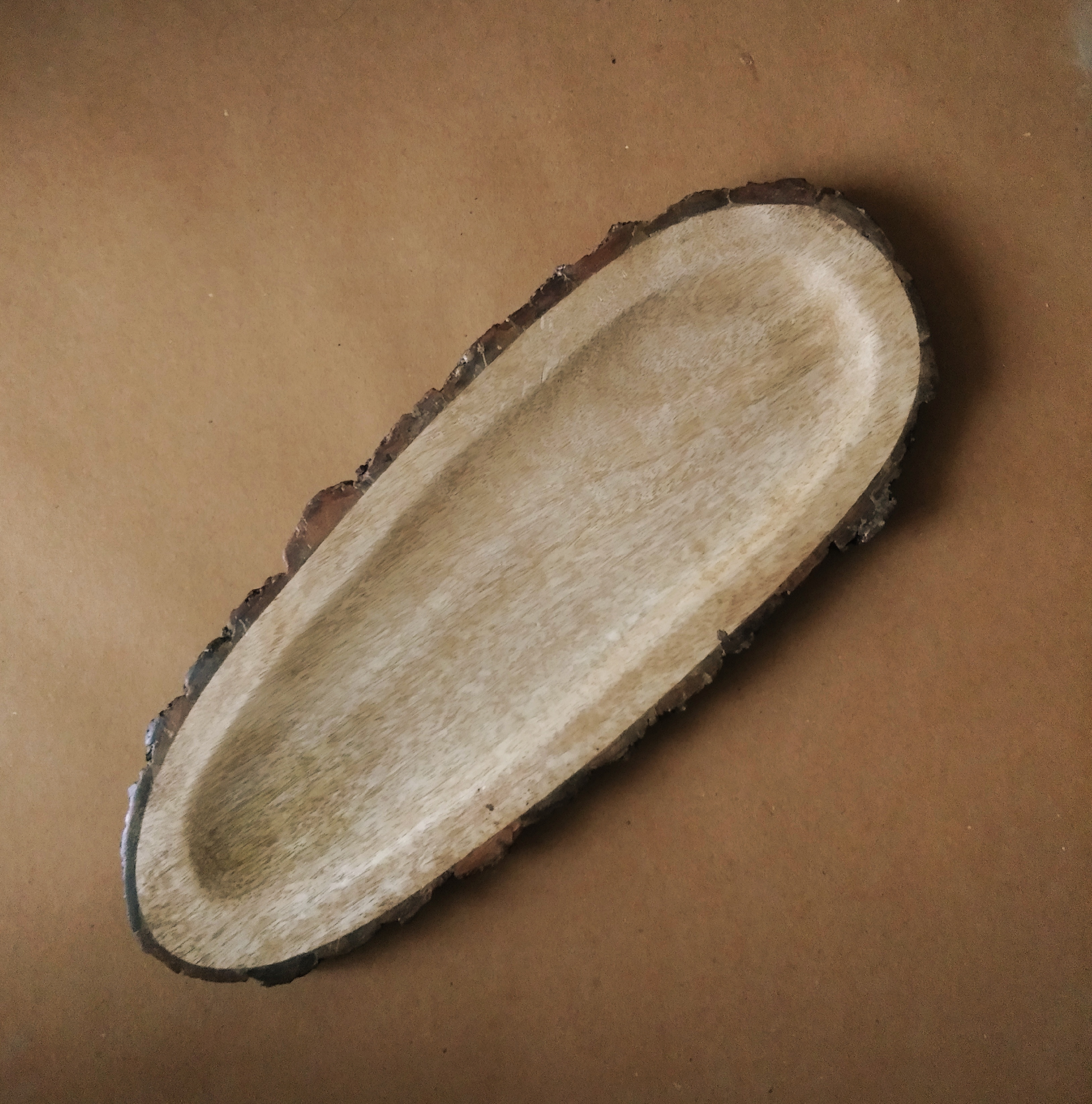 """""""Our Brilla Mango Platter is a lovely long bark platter that will add a luxe rustic flair to your table. Completely food-grade but also brilliant as a decor tray for the living room! Size: 40 x 16 cm"""""""