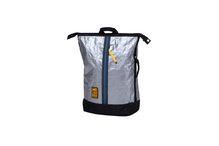 Made from up-cycled tarpaulin, water-resistant, and weighing a mere 450 gms, this bag packs a punch and can carry up to 7 kgs! It also has a separate 'floating' laptop compartment that can fit a 15-inch laptop. Designed to allow you to carry your Bandit 'anyway you like it': backpack, tote, sling, or by the handle by an easy tug of the backstrap; it also has back-pads that provide added comfort to your back. Have fun with changing the look – from a stylish rectangle to a softer rounded top just by an easy clasp of the side buttons.