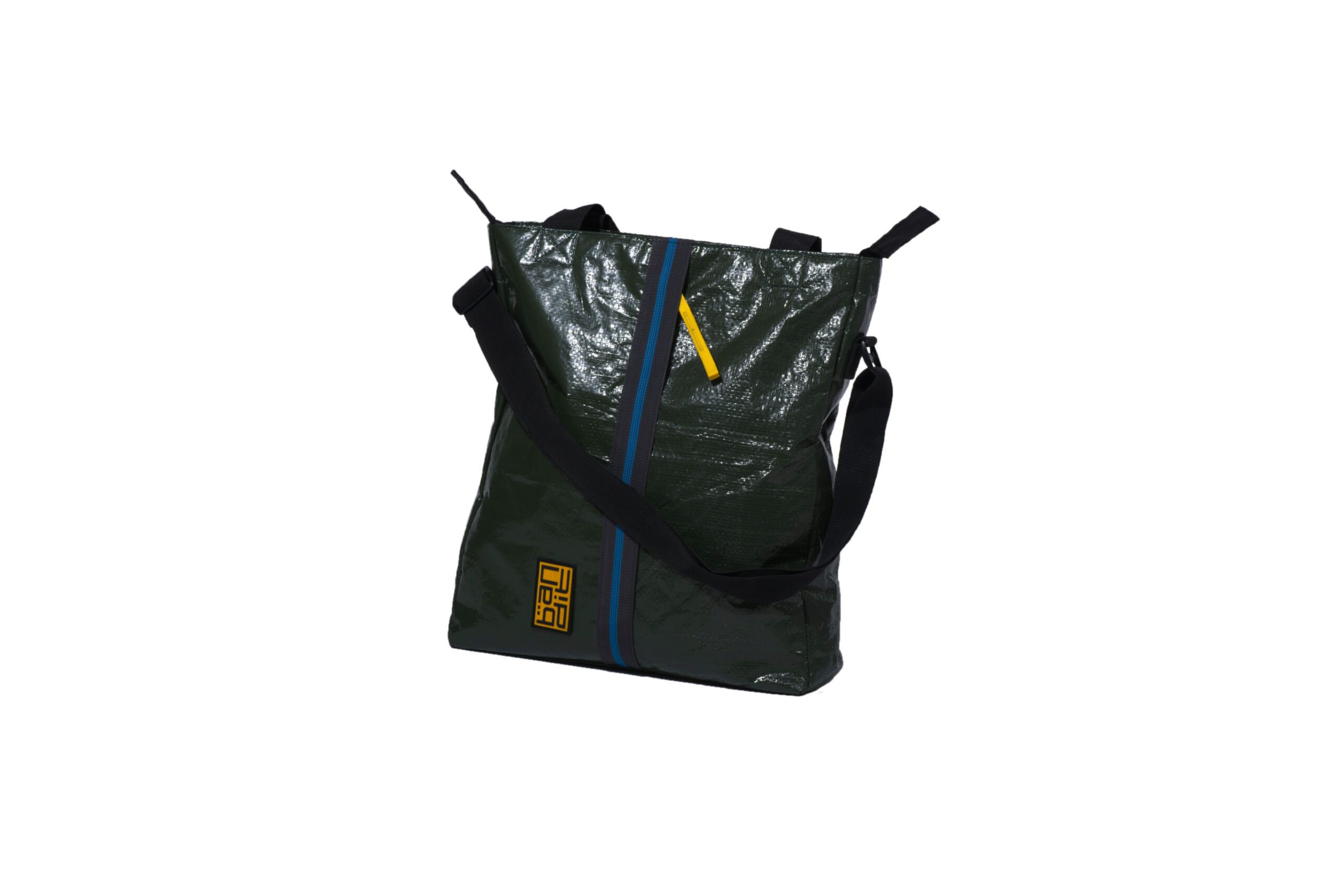 A unisex tote, made from upcycled tarpaulin, water-resistant, and weighing 400 gms, this tote can hold up to 6kg. It also has a separate sleeve for a 13-inch tablet. With a front and rear pockets and a crossbody strap, it can be carried in multiple ways.