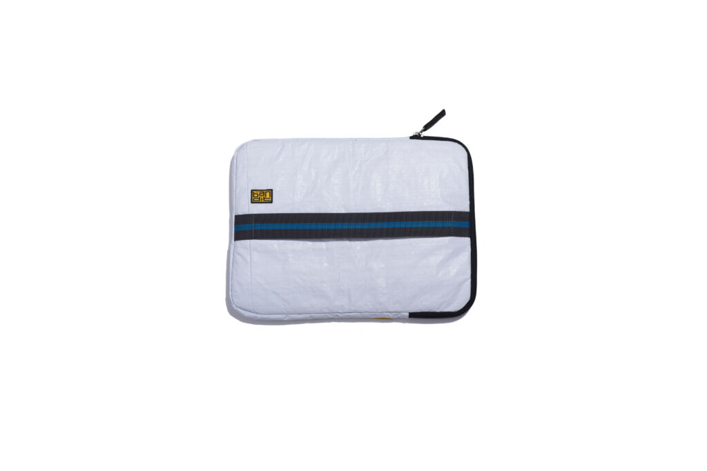Made from up-cycled tarp and water-resistant, this sleeve prevents any accidental spillage and keeps your laptop safe. Apart from the padding, its slip-on handle allows you to firmly clutch your laptop while on the move.