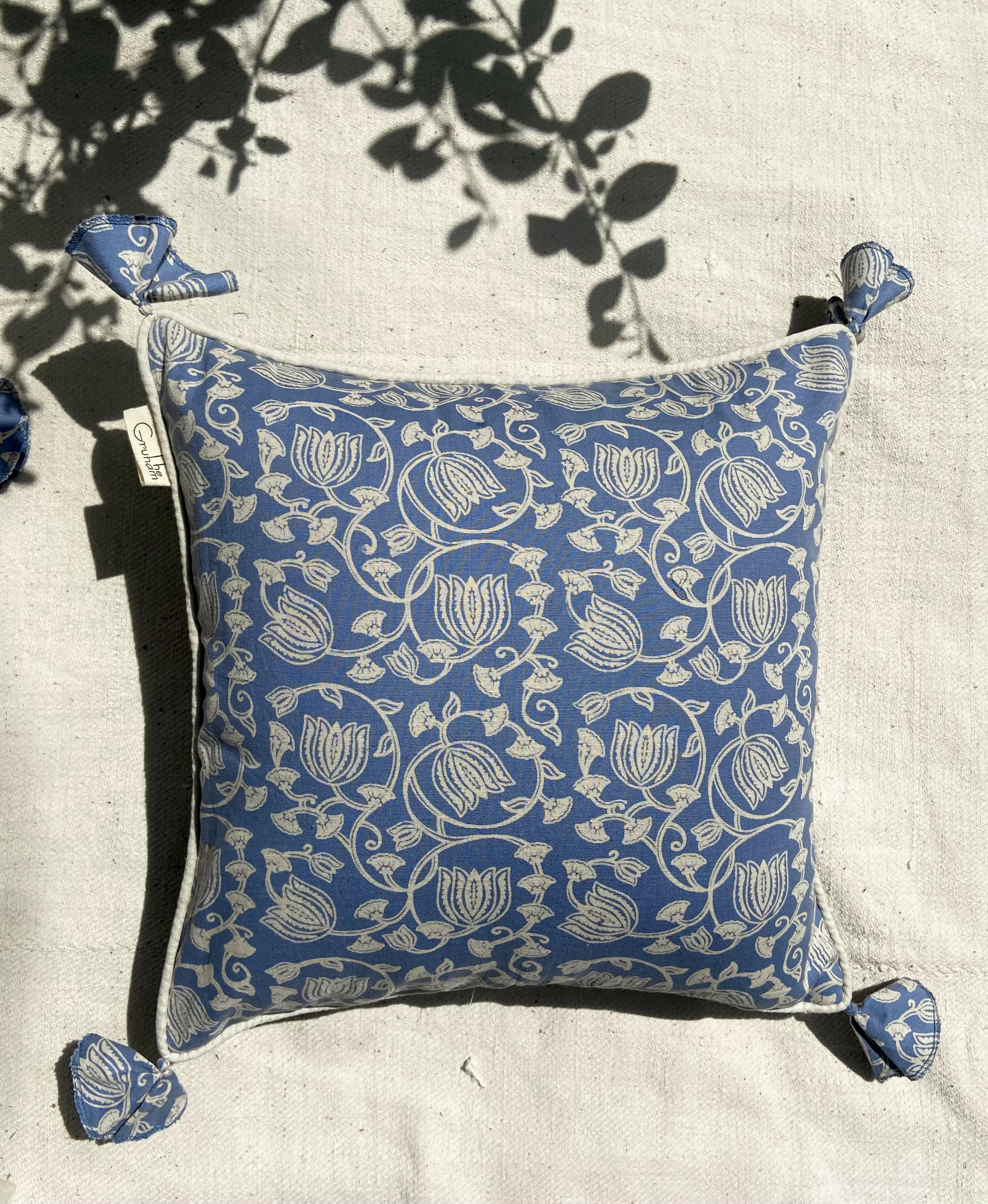 """The stylised florals of this cushion cover, featuring a jaal (mesh pattern) of Mughal-inspired florals achieved through hand-block printing on a base of hand cotton muslin. This Pastel blue cushion cover brings freshness to your spring decor. """"All decorative pillow covers are sewn professionally with finished edges. All seams are over-locked to prevent fraying. However, due to difference in measuring methods, there will be a 1-2 cm size difference which is inevitable. """"YKK Invisible side zipper enclosures for easy removal and cleaning."""