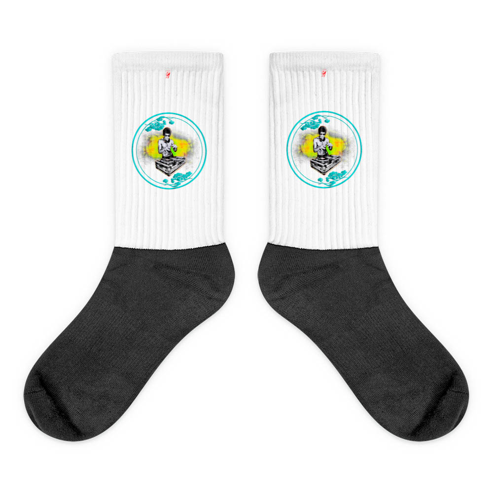 These socks are extra comfortable thanks to their cushioned bottom. The sole is black so never mind the muck! Our artwork printed along the side with crisp, bold colors that are guaranteed to stand out. British unisex fashion house 91 Apparel was originally founded EST. 1991 Work your magic all the time. • Art. no. 26 • Crew length • Machine wash inside out • Cushioned bottom • Ribbed leg • Cold wash with like colors and hang dry • 91 APPAREL logo • Beautiful colors and bold design • Materials ethically sourced from Spain