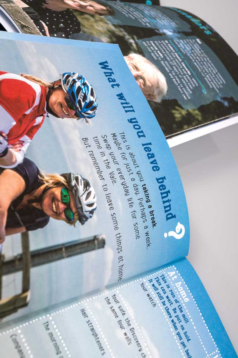 Brochure spread showing cyclists