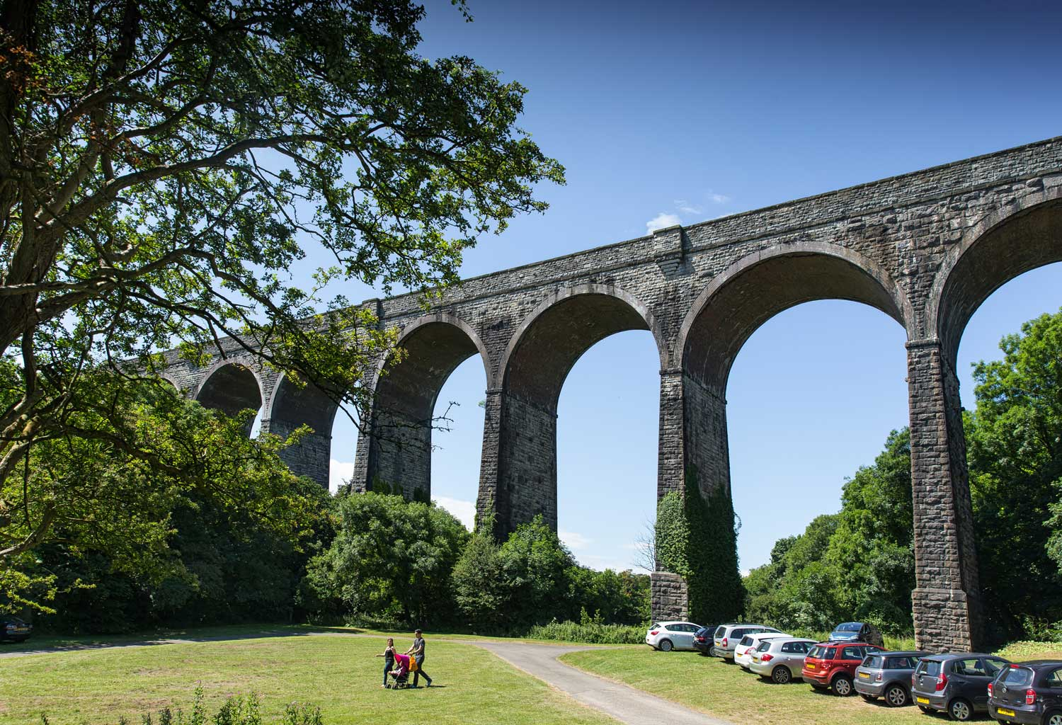 A family walking under Porthkerry Viaduct