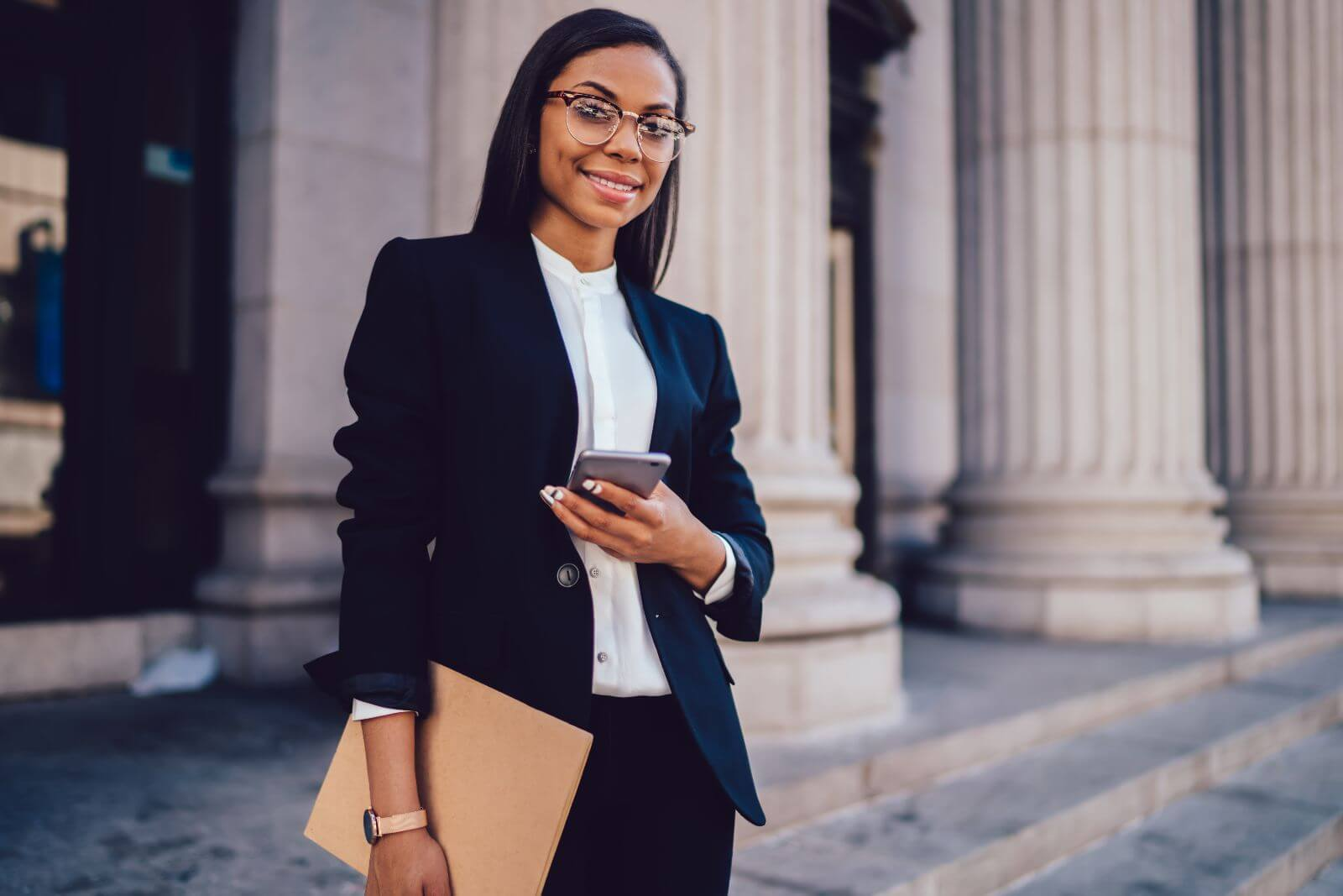Happy black female because she used Eternal Insurance Agency services