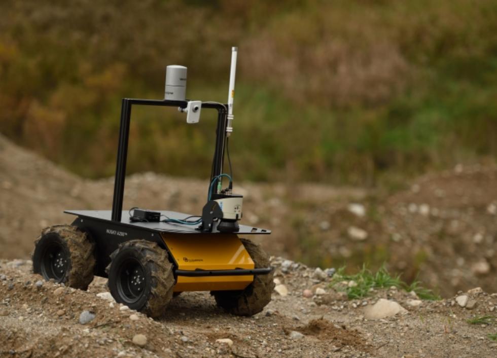 Husky robot driving over dirt
