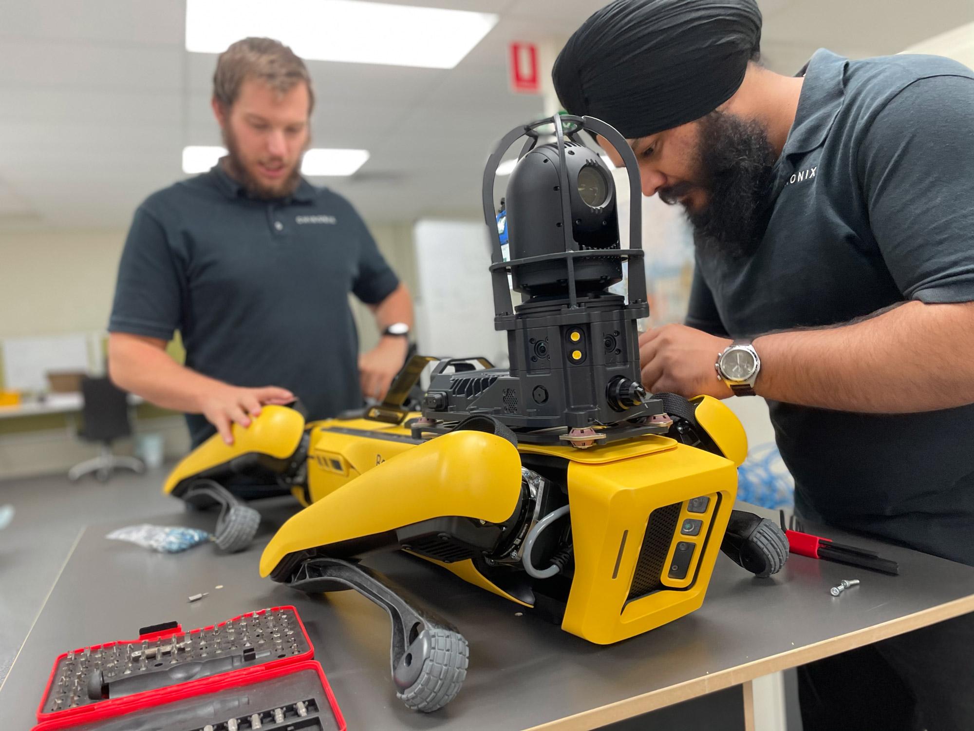 2 roboticists working on a spot robot