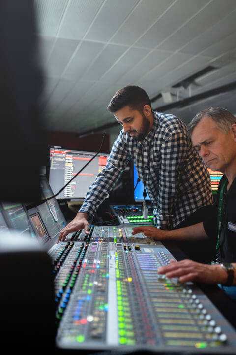 audio engineers on a recording set