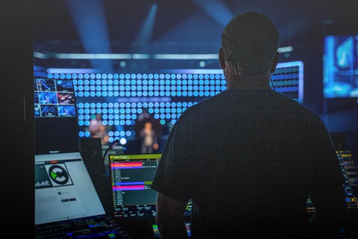 man controlling the recording of a radio segment