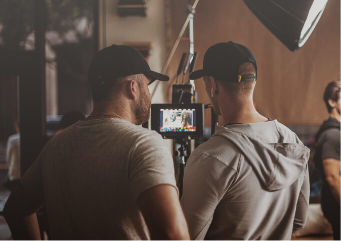 manager talking with an artists on a videoclip recording