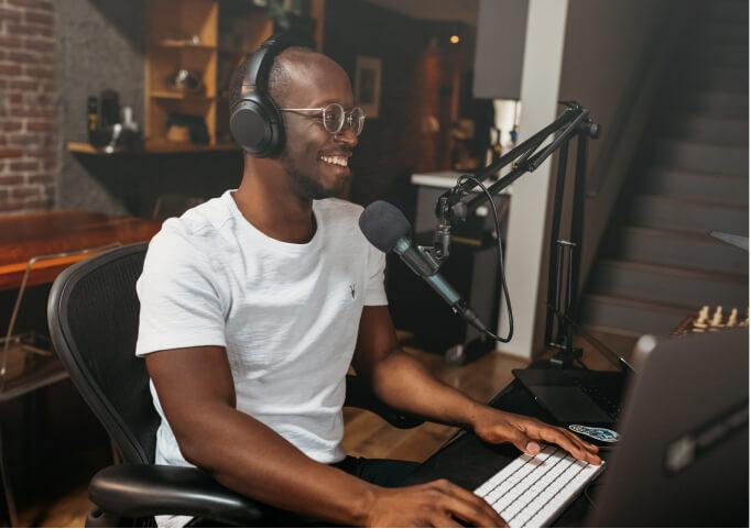 man talking on a radio studio