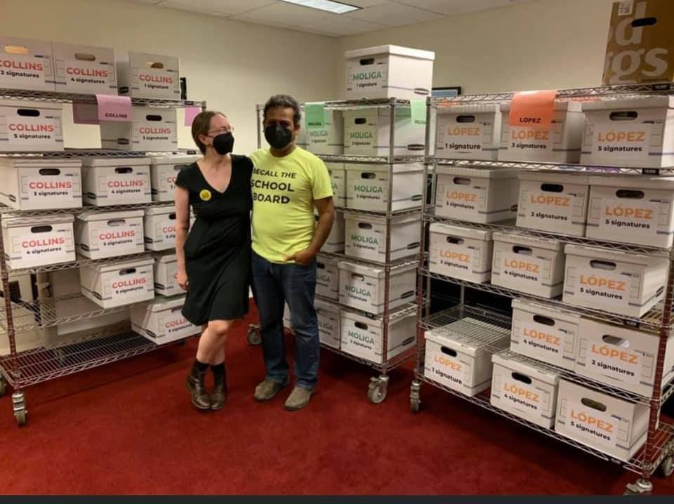Autumn Looijen & Siva Raj with the nearly 240,000 signatures delivered to the Dept of Elections.
