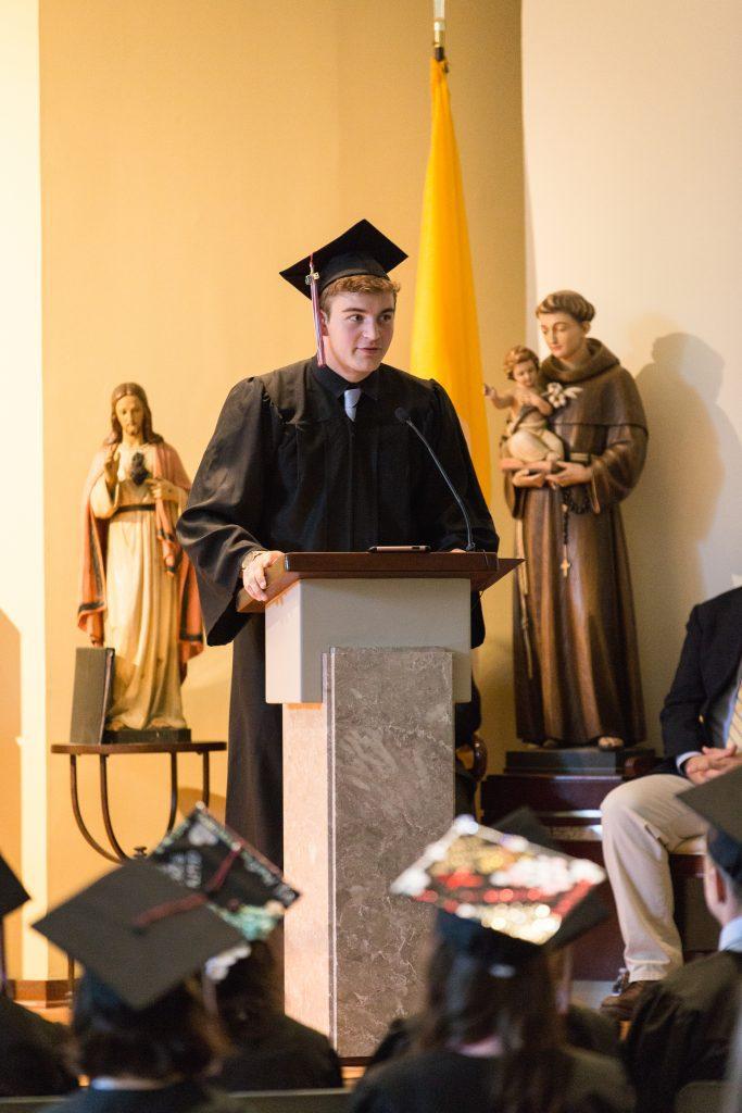 Graduate delivering a speech at a podium