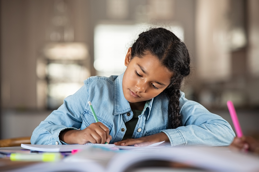Young girl finishing homework