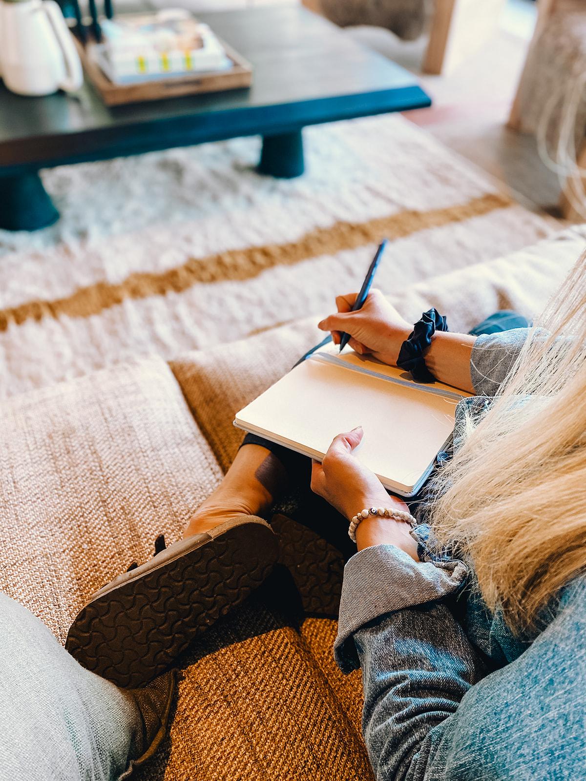 Asian woman journaling Inner Workout
