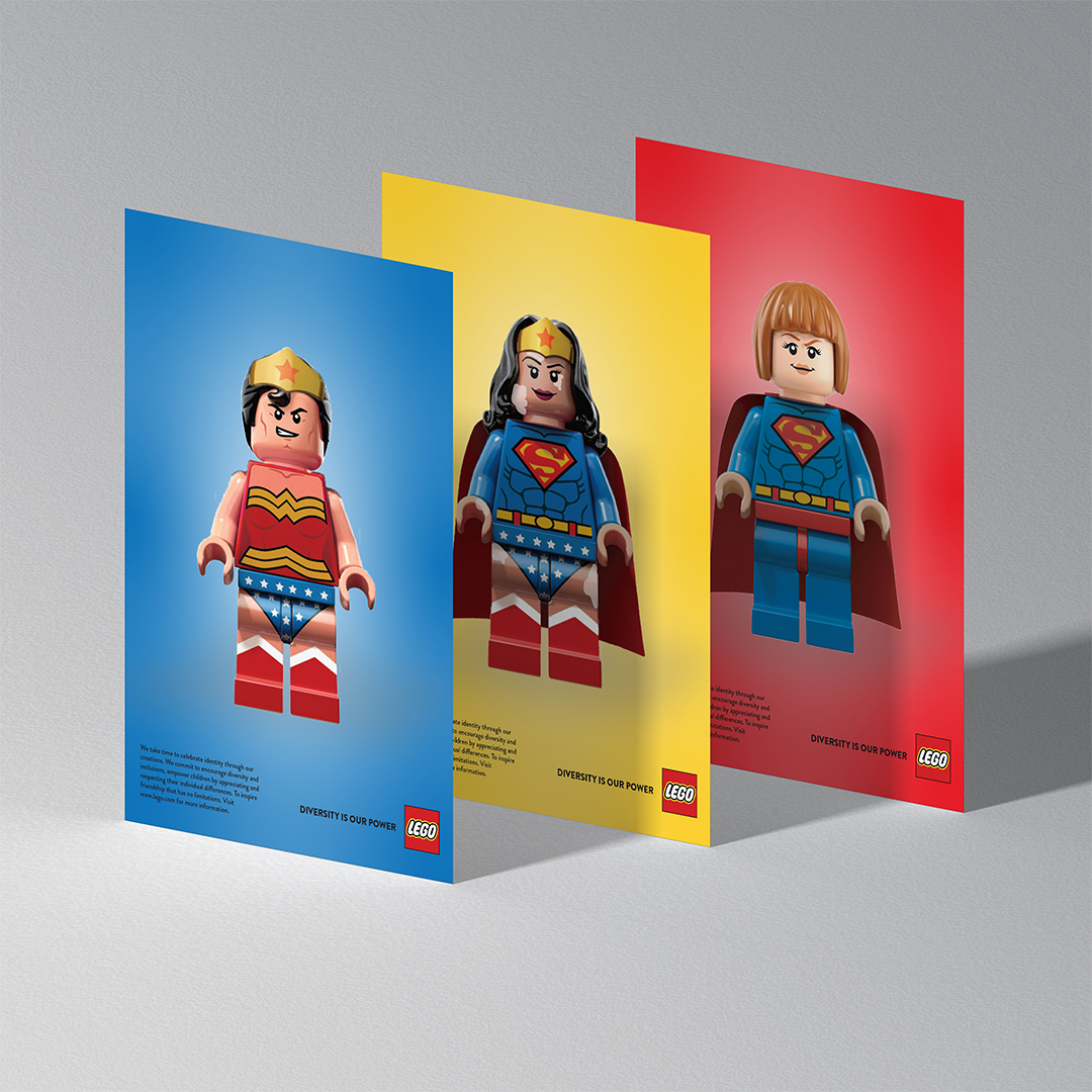 """Three Lego print advertisements, each on a blue, red or yellow background with a Lego character depicting a gender non-specific  super-hero. The tagline reads """"Diversity is Power"""""""