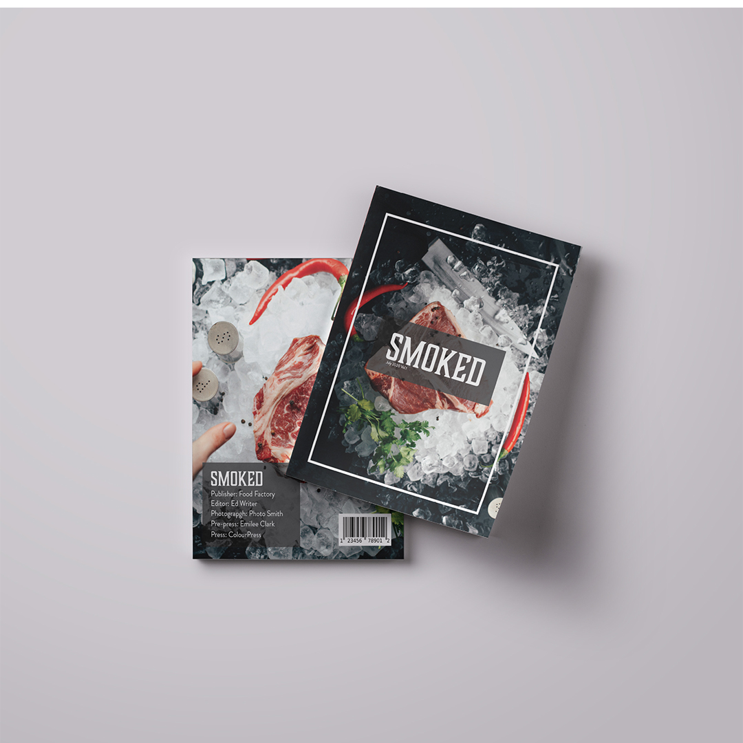 """A photo of a magazine spread. The image is of a cut of raw meat on ice and over the image run the text in large white uppercase letters """"SMOKED."""""""