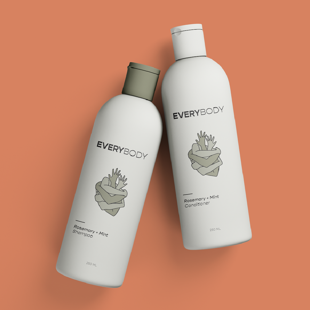 """A photo of a shampoo and conditioner bottle with type that reads """"Everybody"""" """"Rosmary+Mint."""" The logo shows arms of varying shades of grey green hugging."""