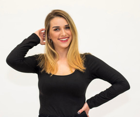 Picture of Abigael, smiling at the camera wearing a black long sleeve shirt
