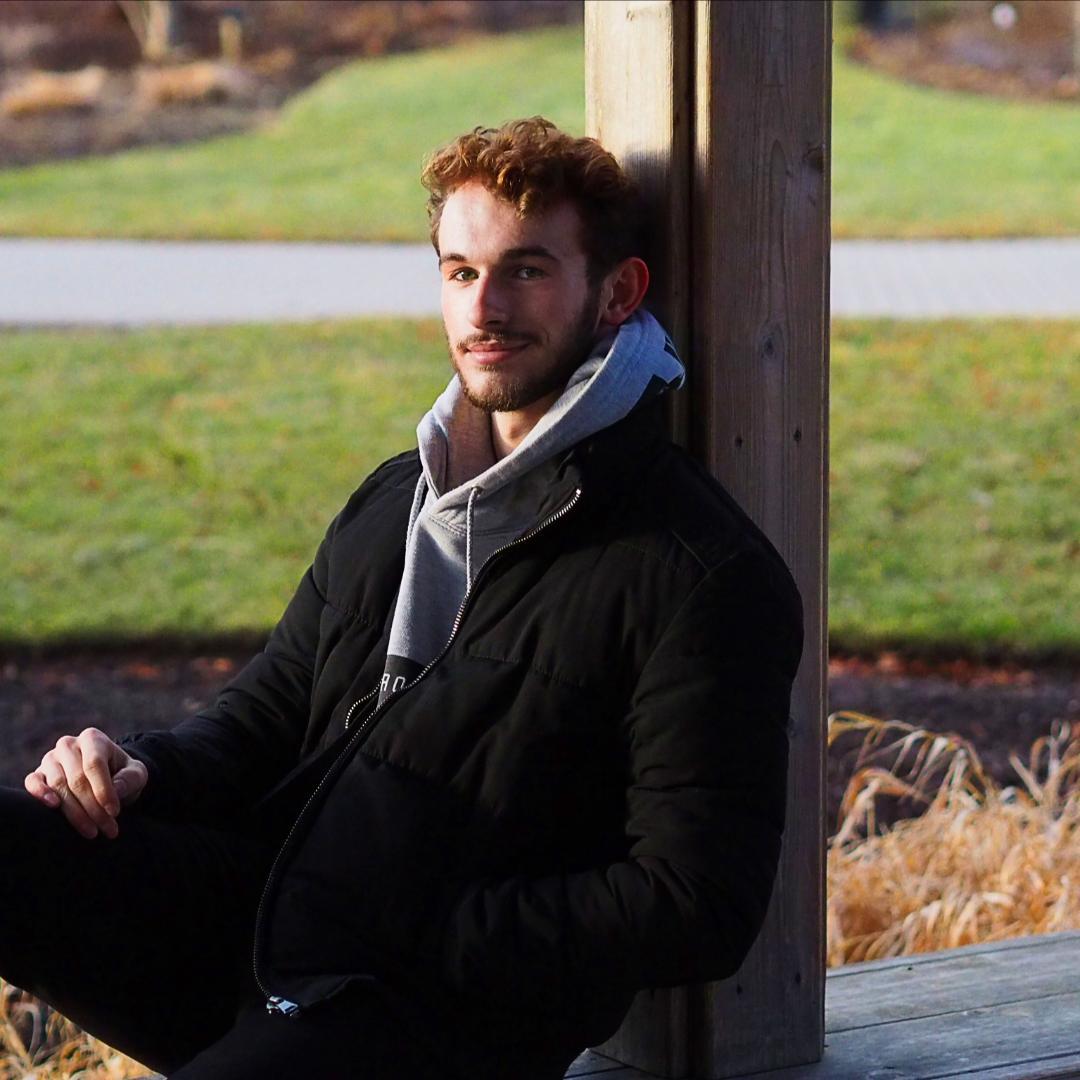 Image of Matt sitting in the park