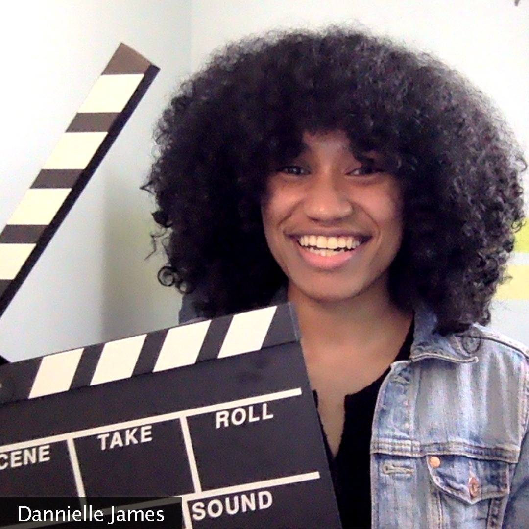 Picture of the creator smiling and holding a clapperboard. The creator's name, Dannielle James, is located in the bottom left corner of the image.