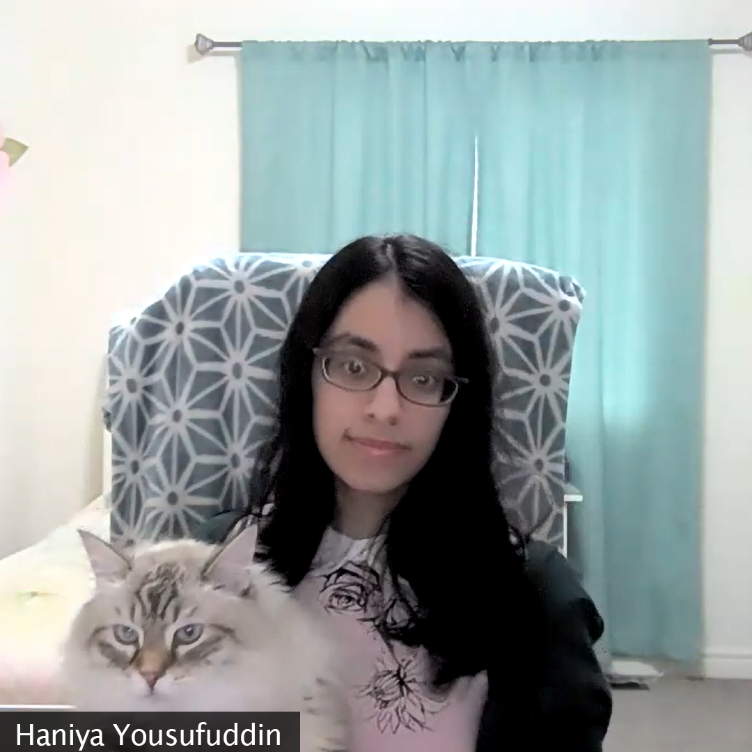 Picture of a girl sitting who is holding her cat, Leo