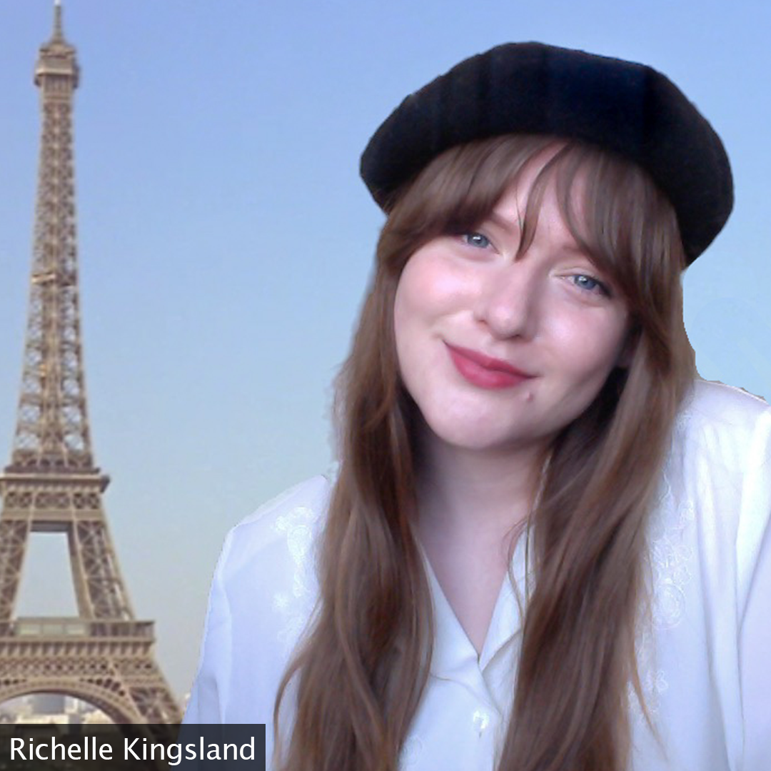 Picture of Richelle Kingsland wearing a beret with an Eiffel Tower Zoom background.