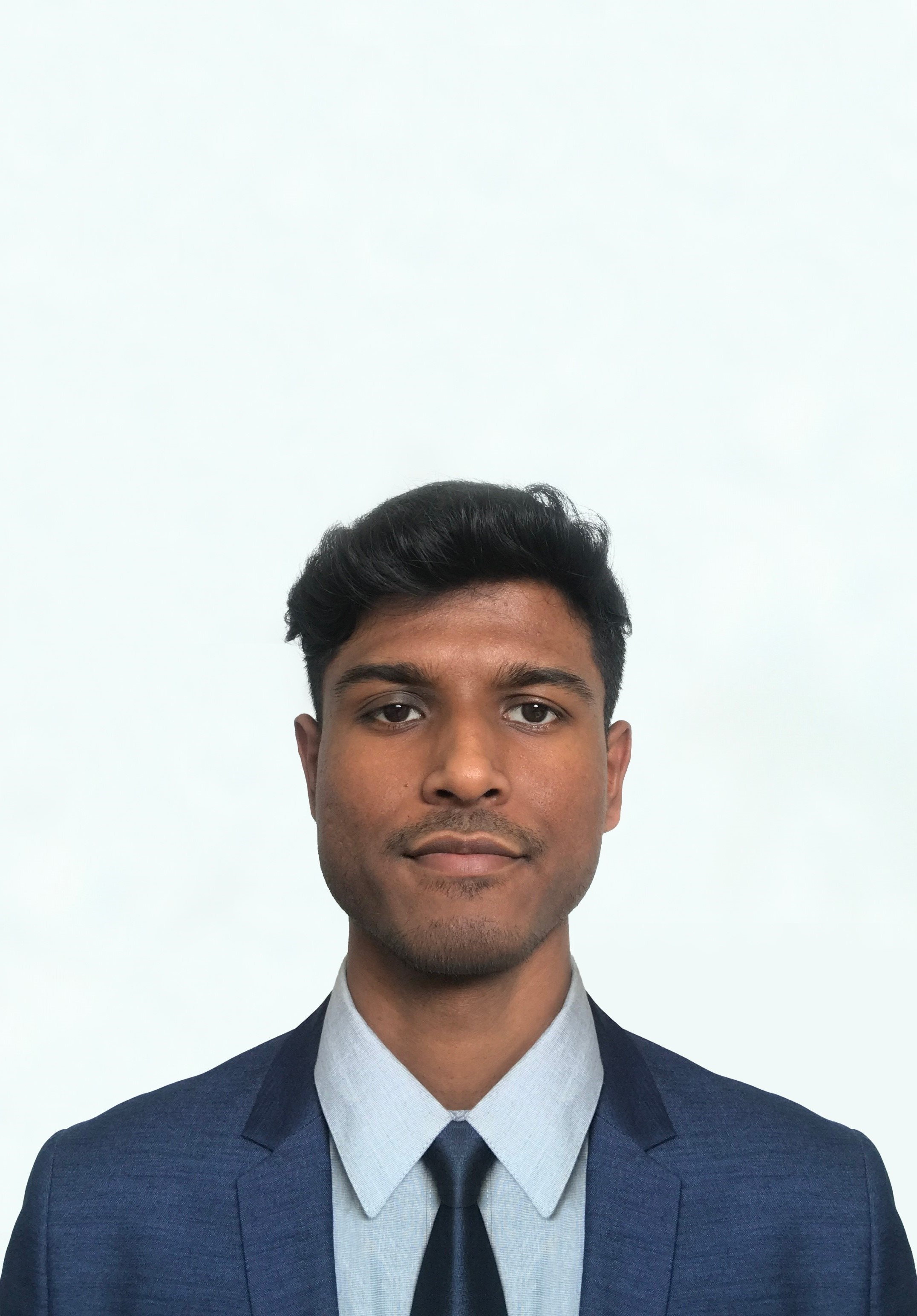 Picture of Dhruv Shah posing wearing a suit and tie