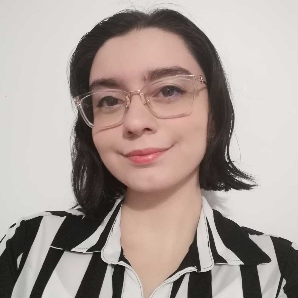 Picture of Farah, wearing a black and white shirt