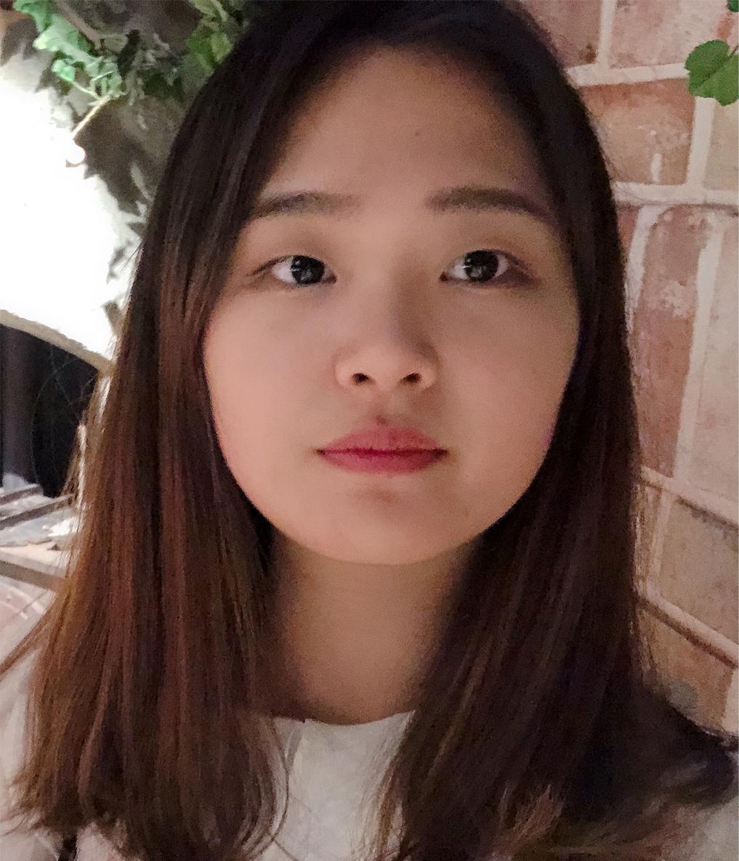 Picutre of Hena Cho wearing a white t-shirt