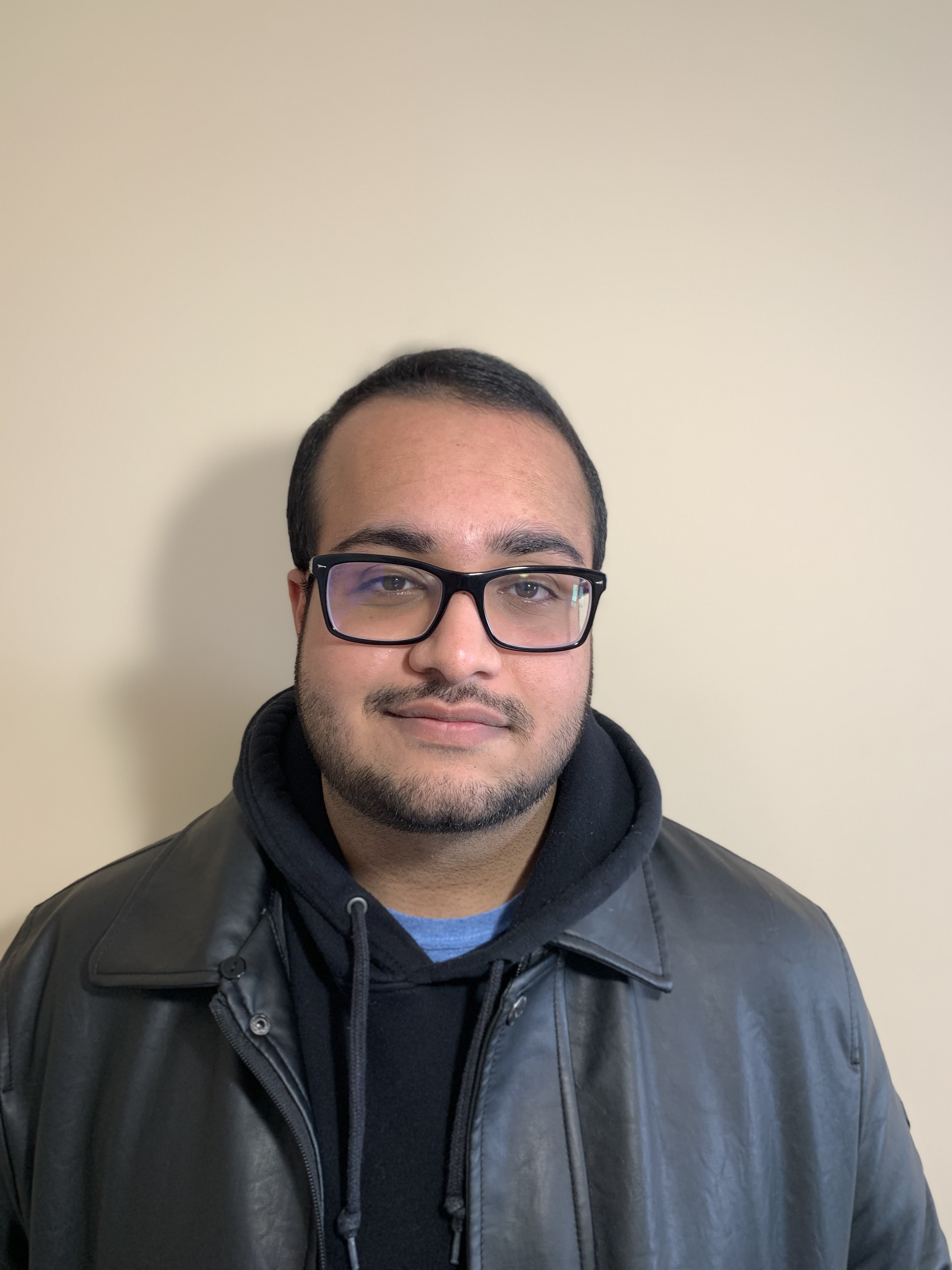 Picture of Hassaan, wearing a black leather jacket