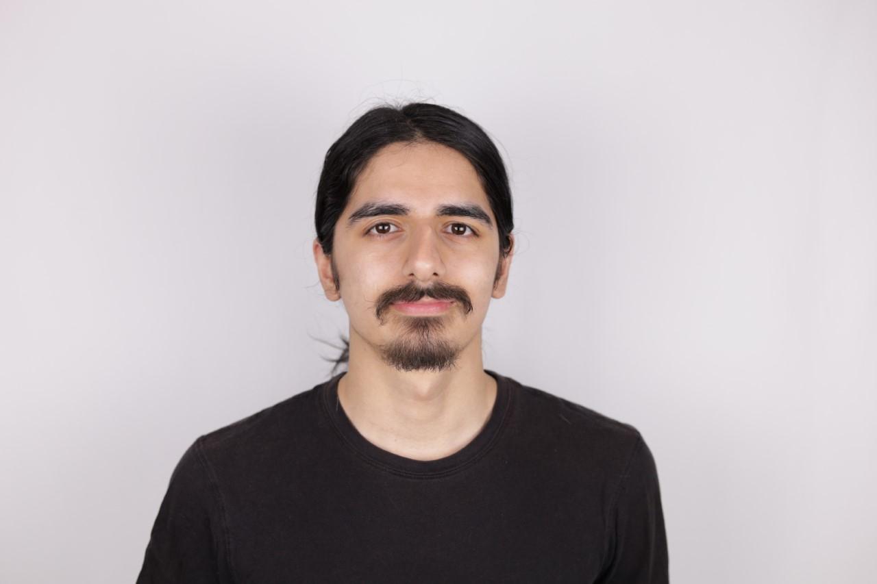 A portrait headshot of Aryan Khandan